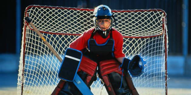 Street hockey goalie(10-12) in front of goal