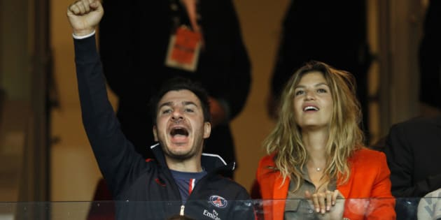 Actor Michael Youn and his girlfriend, model Isabelle Funaro attend the Champions League soccer match between Paris St Germain and Dynamo Kiev at the Parc des Princes stadium in Paris, September 18, 2012.        REUTERS/Benoit Tessier (FRANCE  - Tags: ENTERTAINMENT SPORT SOCCER)