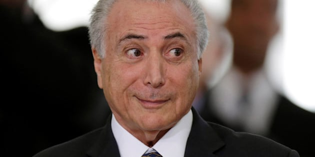 Brazil's interim President Michel Temer reacts during a presentation ceremony of the Delegation of the Olympic Athletes at the Planalto Palace in Brasilia, Brazil July 13, 2016. REUTERS/Ueslei Marcelino