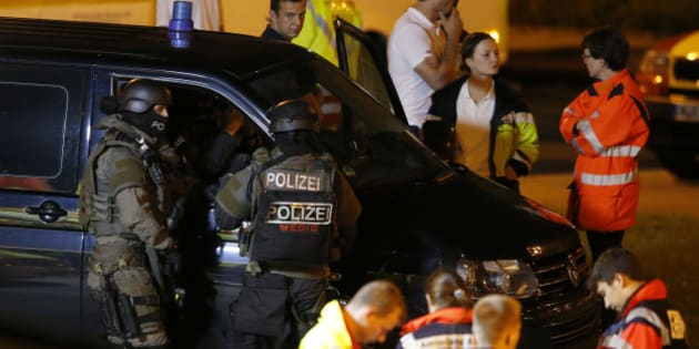 Special force police officers stand in front of a car near the Olympia shopping mall, following a shooting rampage at the mall in Munich, Germany July 23, 2016.   REUTERS/Michael Dalder