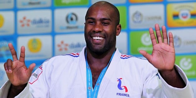 FILE - In this Aug. 29, 2015, file photo, France's Teddy Riner poses during an award ceremony of the men's +100 kg final at the World Judo Championships in Astana, Kazakhstan. The 27-year-old heavyweight has won a record eight world championship titles, five European titles and two Olympic medals, including a gold at the London games. (AP Photo/Alexey Filippov, File)