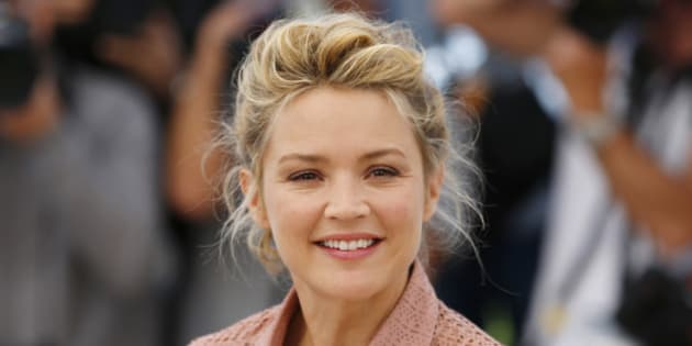"""Cast member Virginie Efira poses during a photocall for the film """"Elle"""" in competition at the 69th Cannes Film Festival in Cannes, France, May 21, 2016.     REUTERS/Yves Herman"""