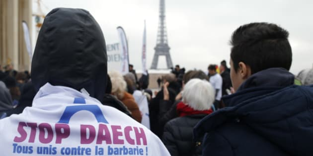 """People attend a demontration against Daech with the message on a shirt with the EIffel Tower, """"All against barbarism"""" in Paris, France, December 13, 2015, a month after fatal shootings in the French capital.  REUTERS/Stephane Mahe"""