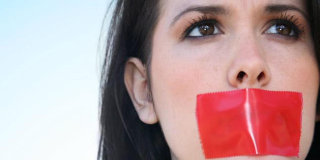 Woman With Red Tape Over Her Mouth Unable To Speak