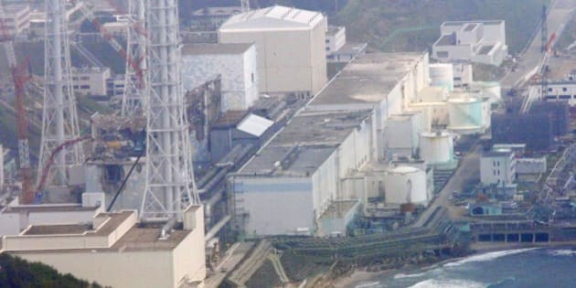 In this aerial photo taken from the Asahi Shimbun helicopter, reactors of the tsunami-stricken Fukushima Dai-ichi nuclear power plant stand in Okuma, Fukushima Prefecture, northeastern Japan, Monday, May 28, 2012. Reactors are, from top center, Unit 1, covered with a beige cover, Unit 2, covered with a light blue cover, Unit 3 and Unit 4, showing their damaged structures surrounded by cranes. The prime minister during Japan's nuclear crisis last year said Monday he had to use an emergency law that never anticipated major radiation leaks and lacked experts capable of giving him guidance. (AP Photo/Tom Curley)