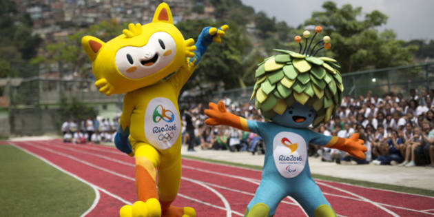 "FILE - This is a Monday, Nov. 24, 2014  file photo of the mascots of the Rio 2016 Olympics, left, and Paralympic Games make their first official appearance at a public school in the Santa Teresa neighborhood of Rio de Janeiro, Brazil. The mascot for the 2016 Olympics in Rio de Janeiro has been named as Vinicius, left,  and the Paralympics mascot will go by the name of Tom it was announced Monday Dec. 15, 2014. The names honor Brazilian musicians and partners Vinicius de Moraes and Tom Jobim. They were exponents of Bossa Nova music and creators of the famous song ""The Girl from Ipanema."" (AP Photo/Felipe Dana, File)"