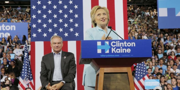 Democratic U.S. presidential candidate Hillary Clinton introduces U.S. Senator Tim Kaine (D-VA) as her vice presidential running mate during a campaign rally in Miami, Florida, U.S. July 23, 2016.  REUTERS/Brian Snyder