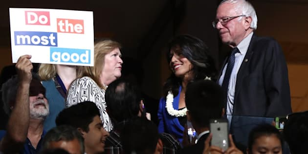 PHILADELPHIA, PA - JULY 26:  Sen. Bernie Sanders along with his wife Jane O'Meara Sanders, stand with US representative Tulsi Gabbard (D-HI) during the second day of the Democratic National Convention at the Wells Fargo Center, July 26, 2016 in Philadelphia, Pennsylvania. An estimated 50,000 people are expected in Philadelphia, including hundreds of protesters and members of the media. The four-day Democratic National Convention kicked off July 25.  (Photo by Jessica Kourkounis/Getty Images)