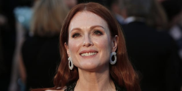 Presenter Julianne Moore wearing a black Chanel gown with beaded embellishments, arrives at the 88th Academy Awards in Hollywood, California February 28, 2016.  REUTERS/Lucas Jackson