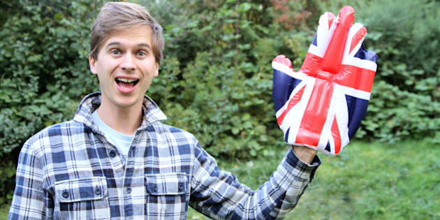Man waving with a novelty Union Jack hand