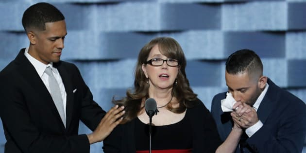 """Christine Leinonen, the mother of Christopher """"Drew"""" Leinonen, who was killed in the nightclub attack in Orlando, is joined on stage by Brandon Wolf, survivor of the nightclub attack in Orlando., and Jose Arraigada, survivor of the nightclub attack in Orlando., as she speaks during the third day of the Democratic National Convention in Philadelphia , Wednesday, July 27, 2016. (AP Photo/J. Scott Applewhite)"""