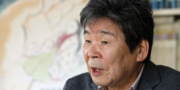"In this Thursday, Feb. 12, 2015 photo, Japanese animated film director Isao Takahata speaks about his latest film ""The Tale of The Princess Kaguya"" with its poster during an interview at his office, Studio Ghibli, in suburban Tokyo. The princess laughs and floats in sumie-brush sketches of faint pastel, a lush landscape that animated film director Isao Takahata has painstakingly depicted to relay his gentle message of faith in this world. But his Oscar-nominated work stands as a stylistic challenge to Hollywood's computer-graphics cartoons, where 3D and other digital finesse dominate. Takahata says those terms with a little sarcastic cough. The 79-year-old co-founder of Japan's prestigious animator, Studio Ghibli, instead stuck to a hand-drawn look. (AP Photo/Shizuo Kambayashi)"