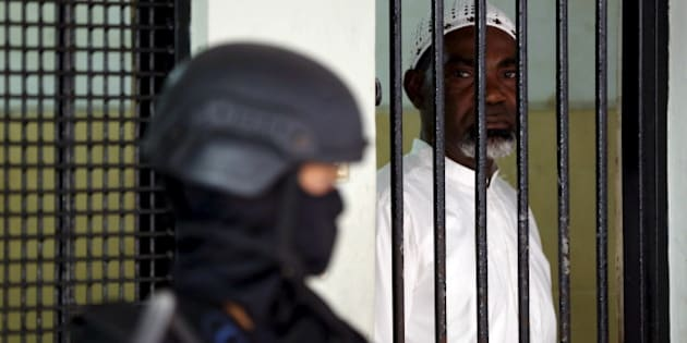 Death row drug convict Martin Anderson from Ghana waits in a holding cell before a judicial review hearing in the South Jakarta court March 19, 2015. Anderson is among a group of 10 drug convicts due to be executed together by firing squad on Nusakambangan. Others in the group include citizens of Australia, France, Brazil, the Philippines, Nigeria and Indonesia. REUTERS/Darren Whiteside