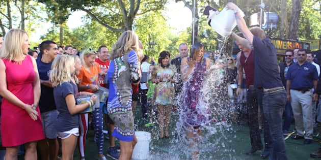 GOOD MORNING AMERICA - The GMA team gets soaked taking the Ice Bucket Challenge, promoting awareness of ALS, on GOOD MORNING AMERICA, 8/15/14, airing on the ABC Television Network.   (Photo by Fred Lee/ABC via Getty Images)   LARA SPENCER, GINGER ZEE