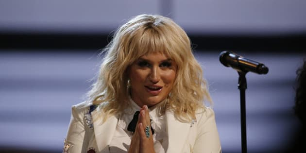 """Kesha gestures after she performed """"It Ain't Me Babe"""" at the 2016 Billboard Awards in Las Vegas, Nevada, U.S., May 22, 2016.  REUTERS/Mario Anzuoni"""