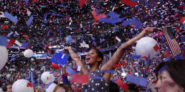 A delegate in the crowd celebrates amidst confetti and balloons after Democratic presidential nominee Hillary Clinton accepted the nomination on the fourth and final night at the Democratic National Convention in Philadelphia, Pennsylvania, U.S. July 28, 2016.  REUTERS/Mark Kauzlarich TPX IMAGES OF THE DAY