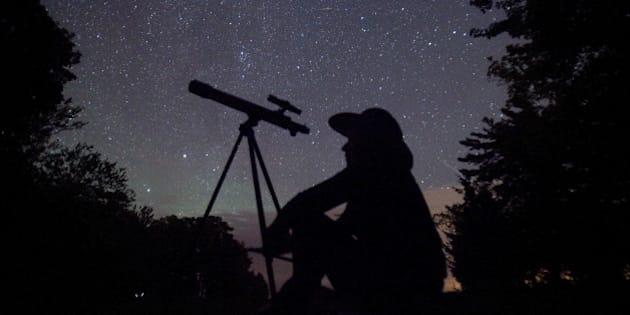 A stargazer waits for the Perseid meteor shower to begin near Bobcaygeon, Ontario, August 12, 2015. Picture taken August 12, 2015. REUTERS/Fred Thornhill