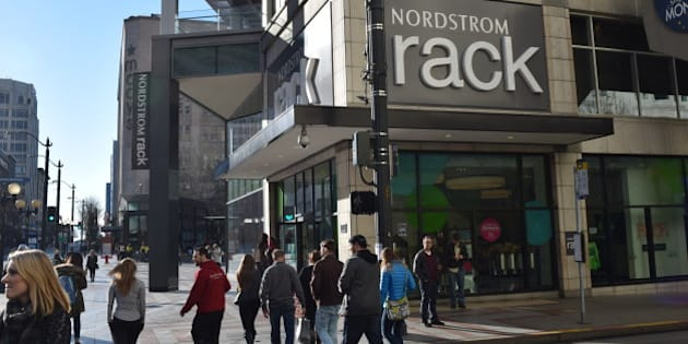 d4c0bf40223 A Nordstrom Rack sign and storefront in the busy Westlake section of  downtown Seattle