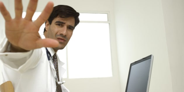 Close-up of a male doctor sticking out his hand