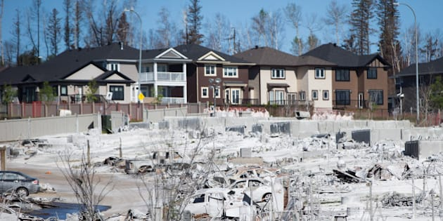 Houses and vehicles destroyed by wildfire are seen in the Timberlea neighborhood of Fort McMurray, Alberta, Canada, on Sunday, June 5, 2016. Residents began returning home Wednesday and companies are resuming operations after Alberta wildfires forced the evacuation of more than 80,000 people from Fort McMurray and knocked more than 1 million barrels of production a day offline this month. Photographer: Darryl Dyck/Bloomberg via Getty Images