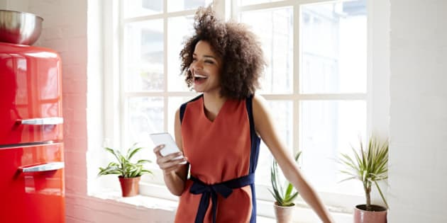Young woman laughing in a trendy apartment