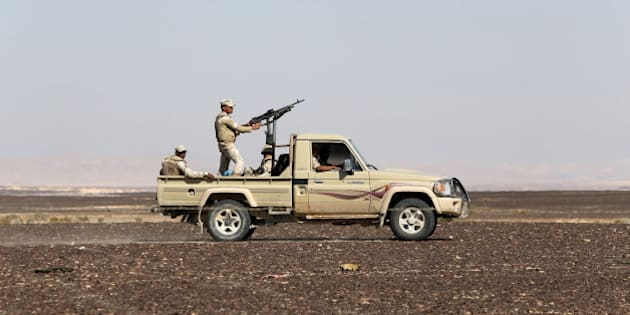 An Egyptian army vehicle guard the site where a Russian airliner crashed in the al-Hasanah area  in El Arish city, north Egypt, November 1, 2015. Russia has grounded Airbus A321 jets flown by the Kogalymavia airline, Interfax news agency reported on Sunday, after one of its fleet crashed in Egypt's Sinai Peninsula, killing all 224 people on board. REUTERS/Mohamed Abd El Ghany