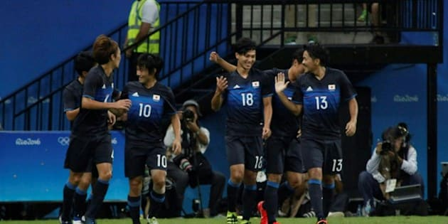 Japan's player Minamino (#18) celebrates after scoring against Nigeria during the football match between Japan and Nigeria for the Olympic Games Rio 2016 in Arena Amazonia, Manaus, Brazil, August 4th, 2016 / AFP PHOTO / Raphael Alves / AFP / RAPHAEL ALVES        (Photo credit should read RAPHAEL ALVES/AFP/Getty Images)