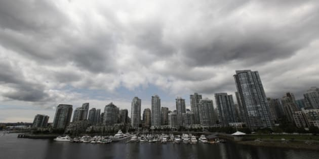 """Residential and commercial buildings are pictured in Vancouver, British Columbia June 20, 2011. Canadian Finance Minister Jim Flaherty said on Monday he continues to monitor the country's housing market, which has some """"hot spots"""", but said the situation remained stable. Canadian house prices have climbed to multi-year highs, helped by low interest rates and the country's still healthy banking system. While the gains have helped power the economic recovery, some officials and economists have fretted about the potential for the boom to become a bubble. REUTERS/Jason Lee (CANADA - Tags: BUSINESS CITYSCAPE ENVIRONMENT IMAGES OF THE DAY)"""