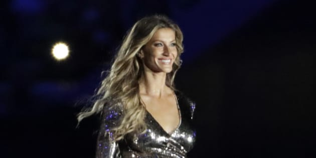 Model Gisele Bundchen walks on stage as 'The Girl from Ipanema' during the opening ceremony for the 2016 Summer Olympics in Rio de Janeiro, Brazil, Friday, Aug. 5, 2016. (AP Photo/David Goldman)