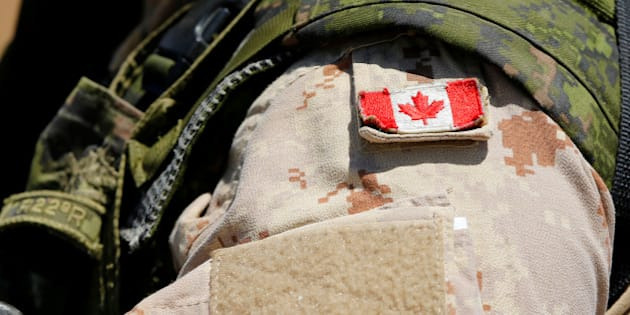 A Canadian soldier from the Royal 22nd Regiment wears a Maple Leaf flag on his uniform during a non-combative extraction operation as part of Rim of the Pacific (RIMPAC) 2016 exercise held at Camp Pendleton, California United States, July 11, 2016. REUTERS/Mike Blake