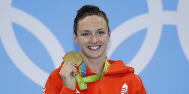 Hungary's Katinka Hosszu shows off her gold medal during the ceremony for the women's 400-meter individual medley final during the swimming competitions at the 2016 Summer Olympics, Saturday, Aug. 6, 2016, in Rio de Janeiro, Brazil. (AP Photo/Michael Sohn)