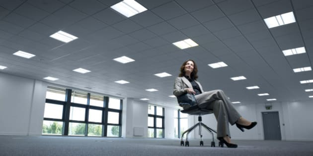 businesswoman admires her new empty offices