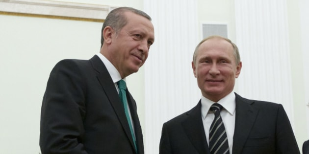 Russian President Vladimir Putin shakes hands with Turkey's President Recep Tayyip Erdogan, left, in Moscow's Kremlin, Russia, Wednesday, Sept.  23, 2015. Putin was joined at Wednesday's ceremonial opening of the Russian capital's new main mosque, by Erdogan and Palestinian President Mahmoud Abbas. (AP Photo/Ivan Sekretarev, Pool)