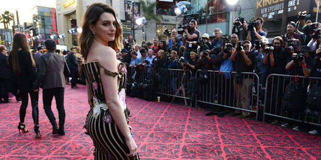 """Anne Hathaway arrives at the premiere of """"Alice Through the Looking Glass"""" at the El Capitan Theatre on Monday, May 23, 2016, in Los Angeles. (Photo by Jordan Strauss/Invision/AP)"""