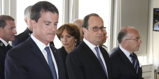 French President Francois Hollande (C), Prime Minister Manuel Valls (L) and Interior Minister Bernard Cazeneuve (R) arrive to attend a meeting at the Prefecture the day after the Bastille Day truck attack, in Nice, France, July 15, 2016.  REUTERS/Eric Gaillard