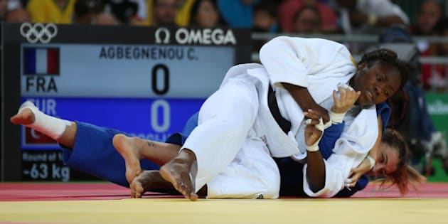 2016 Rio Olympics - Judo - Preliminary - Women -63kg Elimination Rounds - Carioca Arena 2 - Rio de Janeiro, Brazil - 09/08/2016. Clarisse Agbegnenou (FRA) of France and Busra Katipoglu (TUR) of Turkey compete. REUTERS/Toru Hanai FOR EDITORIAL USE ONLY. NOT FOR SALE FOR MARKETING OR ADVERTISING CAMPAIGNS.