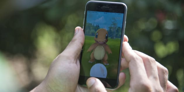 "In this Friday, July 22, 2016 photo, a Pokemon Go player attempts to catch Charmander, one of Pokemon's most iconic creature, in New Delhi, India. ""Pokemon Go,"" the highly addictive online game, has landed in India and thousands are out searching for pokemon characters as the mania spreads. Although it has not been launched officially in India, the augmented-reality-based game has caught on, with fans also using virtual private networks (VPNs) to change their locations and catch pokemons in New York and London while sitting in their Indian homes. (AP Photo/Thomas Cytrynowicz)"