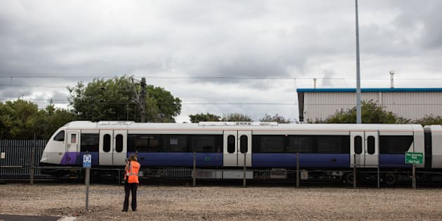A photographer watches an Aventra Class 345 electric multiple-unit test train, manufactured by Bombarider Inc., to be used on the Elizabeth Line as part of the Crossrail project, travel on the test track at the Bombardier Transportation UK Ltd. Rail Vehicles Production Site in Derby, U.K., on Friday, July 29, 2016. Crossrail, approved in 2008 to cut journey times across London and the Southeast, is Europe's largest construction project. Photographer: Simon Dawson/Bloomberg via Getty Images
