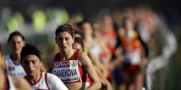 Bulgaria's Silvia Danekova and other runners compete in the Senior Women's race at the European Cross Country Championships in Belgrade, Serbia, Sunday, Dec. 8, 2013. (AP Photo/ Marko Drobnjakovic)