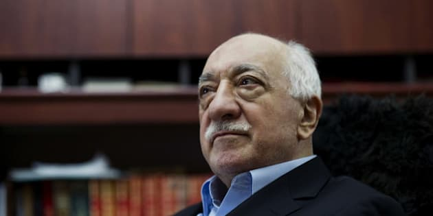 FILE - In this March 15, 2014 file photo, Turkish Muslim cleric Fethullah Gulen, sits at his residence in Saylorsburg, Pa.In a dispute between NATO allies, Turkey demands that the United States extradite Fethullah Gulen, a Pennsylvania-based Turkish cleric, to face charges of engineering a coup attempt. But despite indications that his followers were behind the failed military uprising, analysts say concerns about whether Gulen could get a fair trial complicate Turkey's bid. (AP Photo/Selahattin Sevi, File)