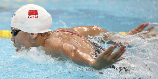 China's Chen Xinyi swims in her women's 100m butterfly heat at the 17th Asian Games in Incheon, South Korea,  Tuesday, Sept. 23, 2014.(AP Photo/Rob Griffith)