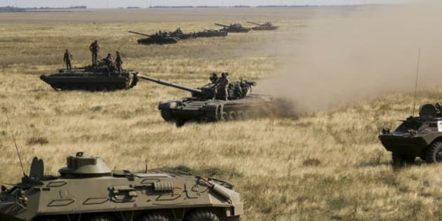 Ukrainian tanks and APCs move towards the de-facto border with Crimea near Kherson, southern Ukraine, Friday, Aug. 12, 2016. Ukraine put its troops on combat alert Thursday along the country's de-facto borders with Crimea and separatist rebels in the east amid an escalating war of words with Russia over Crimea. (AP Photo/Aleksandr Shulman)