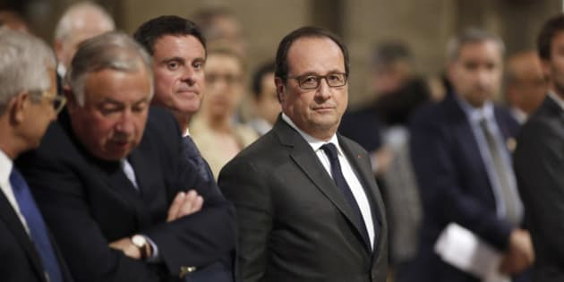 French President Francois Hollande, right, stands next to his Prime Minister Manuel Valls before a mass to pay tribute to French priest Father Jacques Hamel at the Notre-Dame Cathedral in Paris, France, Wednesday, July 27, 2016. Father Jacques Hamel was killed on Tuesday in an attack on a church at Saint-Etienne-du-Rouvray near Rouen, Normandy, that was carried out by assailants linked to Islamic State. (Benoit Tessier/Pool Photo via AP)