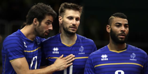 France's Franck Lafitte, left, Antonin Rouzier and Earvin Ngapeth (9) walk to shake hands with member of team United States after a men's preliminary volleyball match at the 2016 Summer Olympics in Rio de Janeiro, Brazil, Saturday, Aug. 13, 2016. (AP Photo/Matt Rourke)