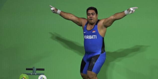 2016 Rio Olympics  Weightlifting - Final - Men's 105kg - Riocentro - Pavilion 2 - Rio de Janeiro, Brazil - 15/08/2016. David Katoatau (KIR) of Kiribati dances off the weightlifting platform. REUTERS/Stoyan Nenov FOR EDITORIAL USE ONLY. NOT FOR SALE FOR MARKETING OR ADVERTISING CAMPAIGNS.
