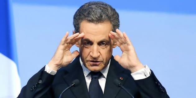 file - In this Sept.27, 2015 file photo, former French President Nicolas Sarkozy reacts during the meeting of Conservative Republicans  in Nogent-sur-Marne, outside Paris. French magistrates handed  Sarkozy preliminary charges Tuesday Feb.26, 2016 for suspected illegal overspending on his failed 2012 re-election campaign, his latest legal trouble ahead of an expected new presidential bid next year. (AP Photo/Jacques Brinon, File)