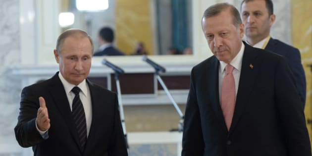 Russian President Vladimir Putin, left, and Turkish President Recep Tayyip Erdogan attend a news conference in the Konstantin palace outside St. Petersburg, Russia, Tuesday, Aug. 9, 2016. Turkish President Recep Tayyip Erdogan said Tuesday after talks with Russia's President Vladimir Putin that the two nations can rebuild their damaged ties and make them even closer, promising to back major energy projects with Russia. (Alexei Nikolsky/Sputnik, Kremlin Pool Photo via AP)
