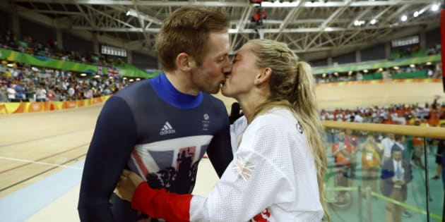 Laura Trott, right, kisses her fiance Jason Kenny, left, both of Britain, after he won the men's keirin cycling final at the Rio Olympic Velodrome during the 2016 Summer Olympics in Rio de Janeiro, Brazil, Tuesday, Aug. 16, 2016. (AP Photo/Patrick Semansky)