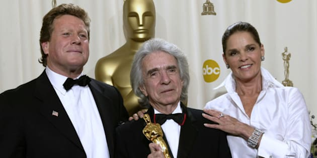 Arthur Hiller (C) holds his Jean Hersholt Humanitarian Award while standing with Ryan O'Neal (L) and Ali McGraw (R) during the 74th annual Academy Awards in Hollywood, California, U.S. March 24, 2002. REUTERS/Mike Blake/File Photo
