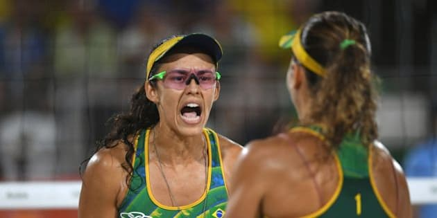Brazil's Talita Rocha (L) reacts during the women's beach volleyball bronze medal match between Brazil and the USA at the Beach Volley Arena in Rio de Janeiro on August 17, 2016, for the Rio 2016 Olympic Games. / AFP / Yasuyoshi Chiba        (Photo credit should read YASUYOSHI CHIBA/AFP/Getty Images)